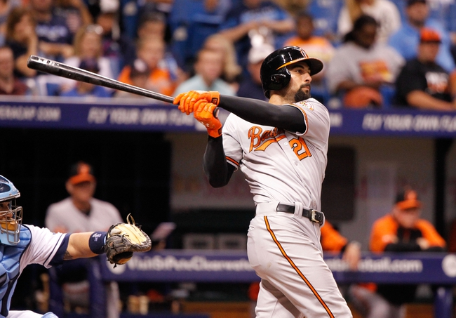 Jun 17, 2014; St. Petersburg, FL, USA; Baltimore Orioles right fielder Nick Markakis (21) at bat against the Tampa Bay Rays at Tropicana Field. Mandatory Credit: Kim Klement-USA TODAY Sports