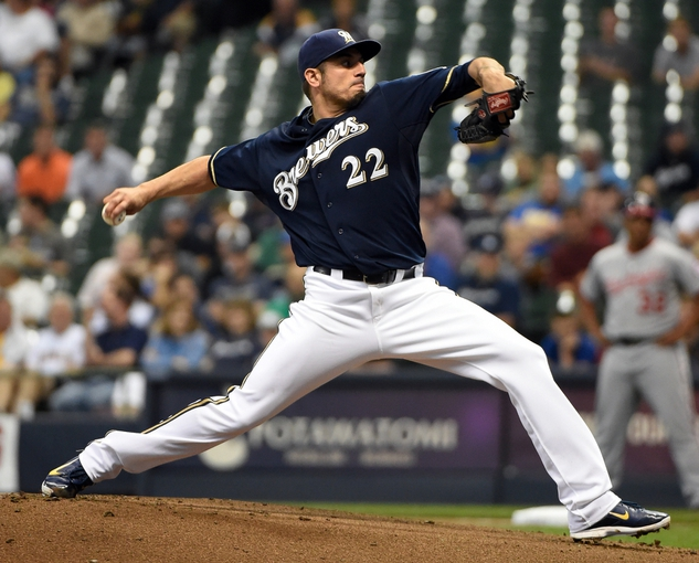 Jun 23, 2014; Milwaukee, WI, USA;   Milwaukee Brewers pitcher Matt Garza (22) pitches in the first inning against the Washington Nationals at Miller Park. Mandatory Credit: Benny Sieu-USA TODAY Sports
