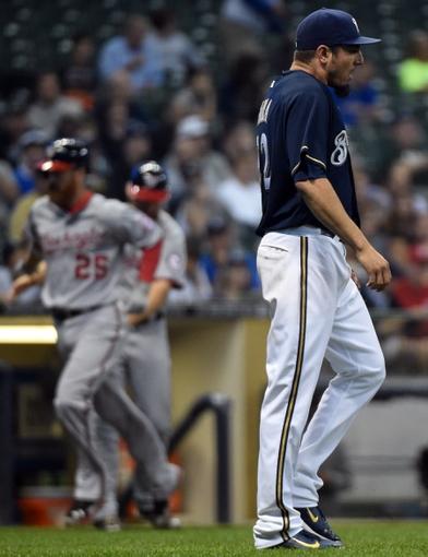 Jun 23, 2014; Milwaukee, WI, USA;   Milwaukee Brewers pitcher Matt Garza (22) reacts after giving up a 3-run home run to Washington Nationals first baseman Adam LaRoche (25) in the third inning at Miller Park. Mandatory Credit: Benny Sieu-USA TODAY Sports