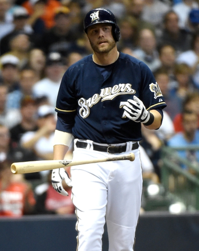 Jun 23, 2014; Milwaukee, WI, USA;  Milwaukee Brewers first baseman Mark Reynolds (7) reacts after striking out in the second inning during the game against the Washington Nationals at Miller Park. Mandatory Credit: Benny Sieu-USA TODAY Sports