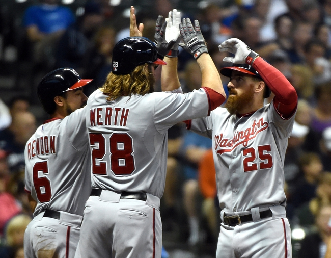 Jun 23, 2014; Milwaukee, WI, USA;   Washington Nationals first baseman Adam LaRoche (25) is greeted by third baseman Anthony Rendon (6) and right fielder Jayson Werth (28) after hitting a 3-run home run in the third inning against the Milwaukee Brewers at Miller Park. Mandatory Credit: Benny Sieu-USA TODAY Sports