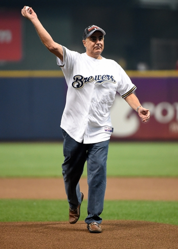 Jun 23, 2014; Milwaukee, WI, USA;  Milwaukee Bucks co-owner Marc Lasry throws the ceremonial first pitch before game between the Milwaukee Brewers and the Washington Nationals at Miller Park. Mandatory Credit: Benny Sieu-USA TODAY Sports