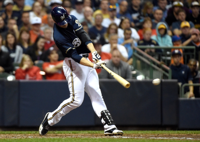 Jun 23, 2014; Milwaukee, WI, USA;  Milwaukee Brewers right fielder Ryan Braun (8) hits a double in the fifth inning against the Washington Nationals at Miller Park. Mandatory Credit: Benny Sieu-USA TODAY Sports