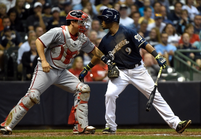 Jun 23, 2014; Milwaukee, WI, USA;  Washington Nationals catcher Jose Lobaton (59) tags Milwaukee Brewers shortstop Jean Segura (9) after a dropped third strike in the seventh inning at Miller Park. Mandatory Credit: Benny Sieu-USA TODAY Sports