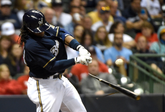 Jun 23, 2014; Milwaukee, WI, USA;  Milwaukee Brewers second baseman Rickie Weeks (23) breaks his bat while grounding out in the eighth inning against the Washington Nationals at Miller Park. Mandatory Credit: Benny Sieu-USA TODAY Sports