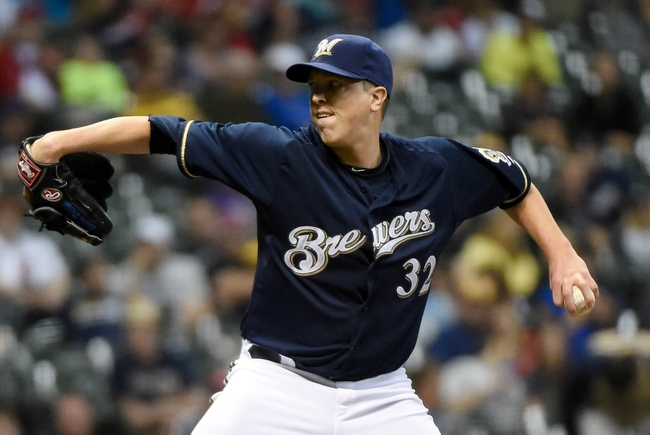 Jun 23, 2014; Milwaukee, WI, USA;  Milwaukee Brewers pitcher Tom Gorzelanny (32) pitches in the ninth inning against the Washington Nationals at Miller Park. Mandatory Credit: Benny Sieu-USA TODAY Sports