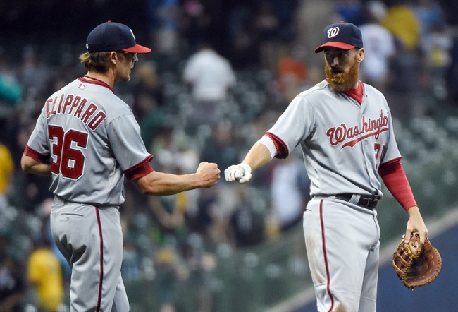 Jun 23, 2014; Milwaukee, WI, USA;  Washington Nationals first baseman Adam LaRoche (25) congratulates pitcher Tyler Clippard (36) after Clippard earned a save against the Milwaukee Brewers at Miller Park. Mandatory Credit: Benny Sieu-USA TODAY Sports