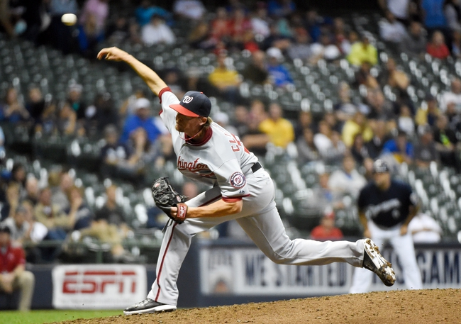 Jun 23, 2014; Milwaukee, WI, USA;   Washington Nationals pitcher Tyler Clippard (36) pitches in the ninth inning against the Milwaukee Brewers at Miller Park. Clippard earned his first save of the season as the Nationals beat the Brewers 3-0.   Mandatory Credit: Benny Sieu-USA TODAY Sports
