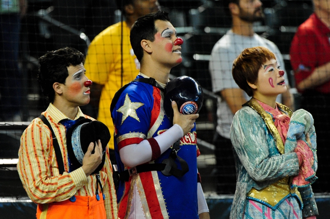 Jun 24, 2014; Phoenix, AZ, USA; Ringling Brothers circus clowns look on during the national anthem prior to the game between the Arizona Diamondbacks and the Cleveland Indians at Chase Field. Mandatory Credit: Matt Kartozian-USA TODAY Sports