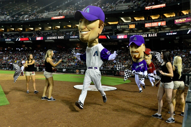 Jun 24, 2014; Phoenix, AZ, USA; The legends character for former Arizona Diamondbacks player Luis Gonzalez wins the race during the fifth inning against the Cleveland Indians at Chase Field. Mandatory Credit: Matt Kartozian-USA TODAY Sports