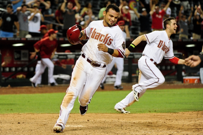 Jun 24, 2014; Phoenix, AZ, USA; Arizona Diamondbacks right fielder Gerardo Parra (8) scores on a hit by second baseman Aaron Hill (not pictured) to beat the Cleveland Indians 9-8 in the fourteenth inning at Chase Field. Mandatory Credit: Matt Kartozian-USA TODAY Sports