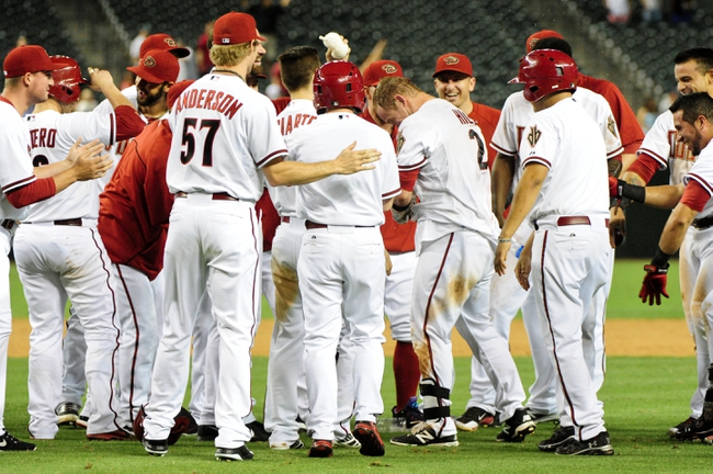 Jun 24, 2014; Phoenix, AZ, USA; Arizona Diamondbacks second baseman Aaron Hill (2) celebrates with teammates after hitting a walk off single to beat the Cleveland Indians 9-8 in the fourteenth inning at Chase Field. Mandatory Credit: Matt Kartozian-USA TODAY Sports