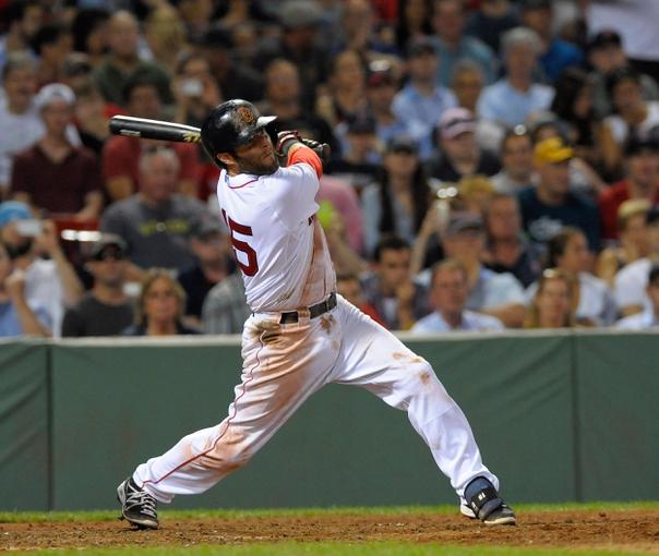 Jun 17, 2014; Boston, MA, USA; Boston Red Sox second baseman Dustin Pedroia (15) hits a single during the eighth inning against the Minnesota Twins at Fenway Park. Mandatory Credit: Bob DeChiara-USA TODAY Sports