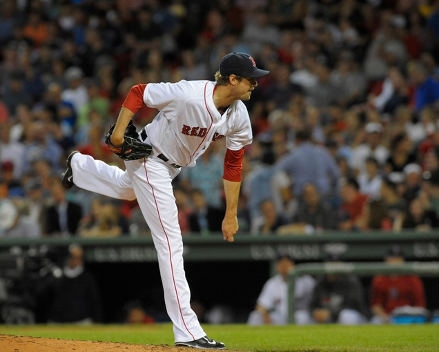 Jun 16, 2014; Boston, MA, USA; Boston Red Sox relief pitcher Andrew Miller (30) pitches during the eighth inning against the Minnesota Twins at Fenway Park. Mandatory Credit: Bob DeChiara-USA TODAY Sports