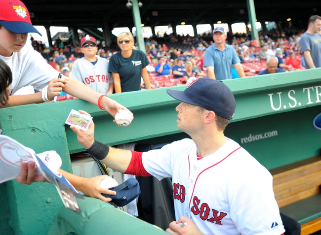 Jun 17, 2014; Boston, MA, USA; Boston Red Sox right fielder Daniel Nava (29) signs an autograph prior to a game against the Minnesota Twins at Fenway Park. Mandatory Credit: Bob DeChiara-USA TODAY Sports