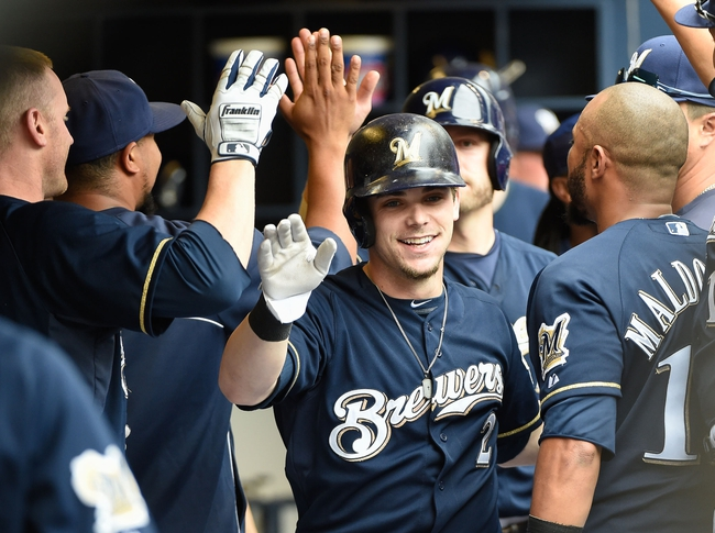 Jun 25, 2014; Milwaukee, WI, USA;  Milwaukee Brewers second baseman Scooter Gennett (2) is greeted in the dugout by his teammates after hitting a grand slam home run in the second inning against the Washington Nationals at Miller Park. Mandatory Credit: Benny Sieu-USA TODAY Sports
