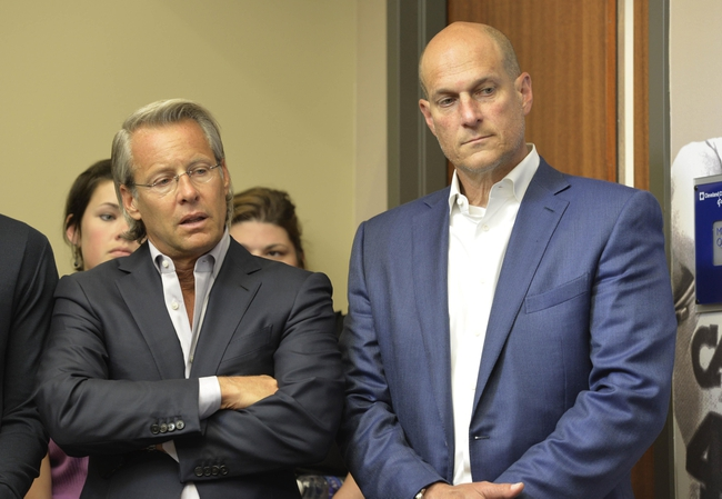 June 25, 2014; Independence, OH, USA; Cleveland Cavaliers managing partner Nate Forbes (left) and vice chairman Jeff Cohen listen during a press conference at Cleveland Clinic Courts. Mandatory Credit: David Richard-USA TODAY Sports