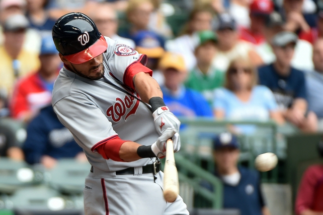 Jun 25, 2014; Milwaukee, WI, USA;  Washington Nationals shortstop Ian Desmond (20) hits a double to drive in a run in the fourth inning against the Milwaukee Brewers at Miller Park. Mandatory Credit: Benny Sieu-USA TODAY Sports
