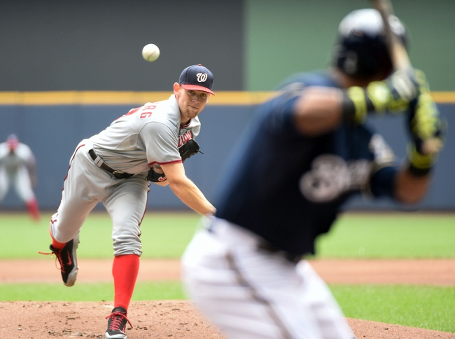 Jun 25, 2014; Milwaukee, WI, USA; Washington Nationals pitcher Stephen Strasburg (37) pitches to Milwaukee Brewers shortstop Jean Segura (9) in the first inning at Miller Park. Mandatory Credit: Benny Sieu-USA TODAY Sports