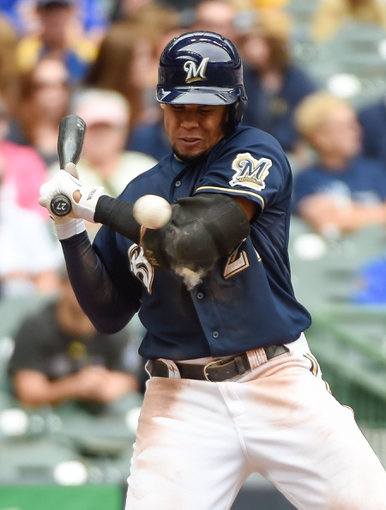 Jun 25, 2014; Milwaukee, WI, USA;  Milwaukee Brewers center fielder Carlos Gomez (27) is hit by a pitch in the eighth inning during the game against the Washington Nationals at Miller Park.  The Brewers beat the Nationals 9-2. Mandatory Credit: Benny Sieu-USA TODAY Sports