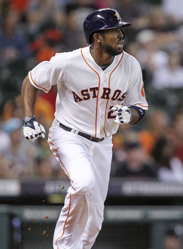 Jun 25, 2014; Houston, TX, USA; Houston Astros center fielder Dexter Fowler (21) hits a double during the first inning against the Atlanta Braves at Minute Maid Park. Mandatory Credit: Troy Taormina-USA TODAY Sports