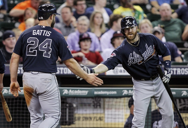 Jun 25, 2014; Houston, TX, USA; Atlanta Braves catcher Evan Gattis (24) is congratulated by designated hitter Ryan Doumit (4) after scoring a run during the second inning against the Houston Astros at Minute Maid Park. Mandatory Credit: Troy Taormina-USA TODAY Sports