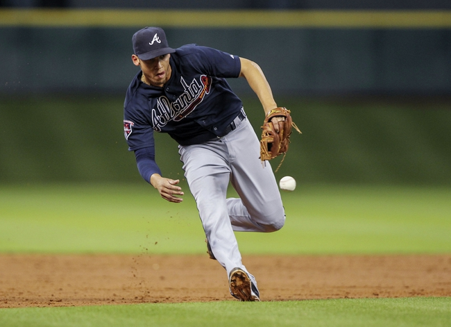 Jun 25, 2014; Houston, TX, USA; Atlanta Braves shortstop Andrelton Simmons (19) fields a ground ball during the third inning against the Houston Astros at Minute Maid Park. Mandatory Credit: Troy Taormina-USA TODAY Sports