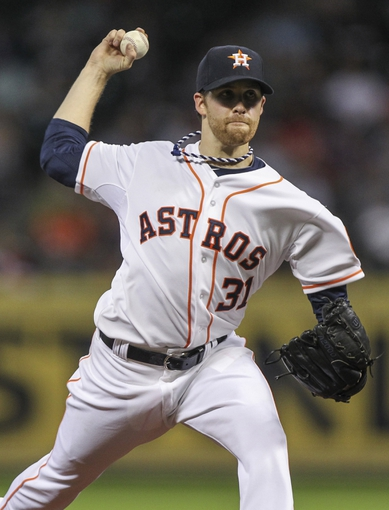 Jun 25, 2014; Houston, TX, USA; Houston Astros starting pitcher Collin McHugh (31) delivers a pitch during the fourth inning against the Atlanta Braves at Minute Maid Park. Mandatory Credit: Troy Taormina-USA TODAY Sports