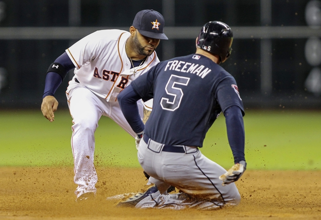 Jun 25, 2014; Houston, TX, USA; Atlanta Braves first baseman Freddie Freeman (5) is out at second base during the sixth inning as Houston Astros shortstop Jonathan Villar (2) applies the tag at Minute Maid Park. Mandatory Credit: Troy Taormina-USA TODAY Sports