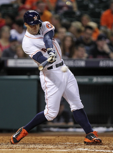 Jun 25, 2014; Houston, TX, USA; Houston Astros right fielder George Springer (4) gets a single during the sixth inning against the Atlanta Braves at Minute Maid Park. Mandatory Credit: Troy Taormina-USA TODAY Sports