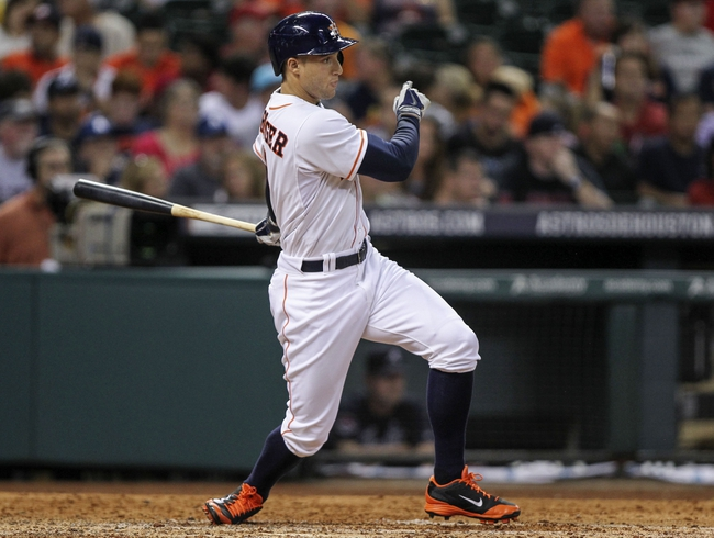 Jun 25, 2014; Houston, TX, USA; Houston Astros right fielder George Springer (4) hits a single during the sixth inning against the Atlanta Braves at Minute Maid Park. Mandatory Credit: Troy Taormina-USA TODAY Sports