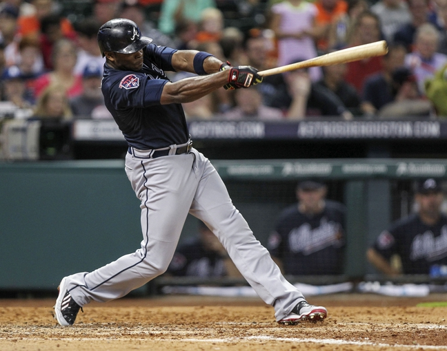 Jun 25, 2014; Houston, TX, USA; Atlanta Braves left fielder Justin Upton (8) hits a home run during the seventh inning against the Houston Astros at Minute Maid Park. Mandatory Credit: Troy Taormina-USA TODAY Sports