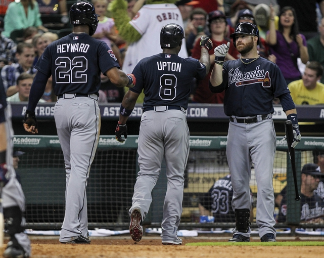 Jun 25, 2014; Houston, TX, USA; Atlanta Braves right fielder Jason Heyward (22) and left fielder Justin Upton (8) are congratulated by designated hitter Ryan Doumit (4) after Upton hits a home run during the seventh inning against the Houston Astros at Minute Maid Park. Mandatory Credit: Troy Taormina-USA TODAY Sports