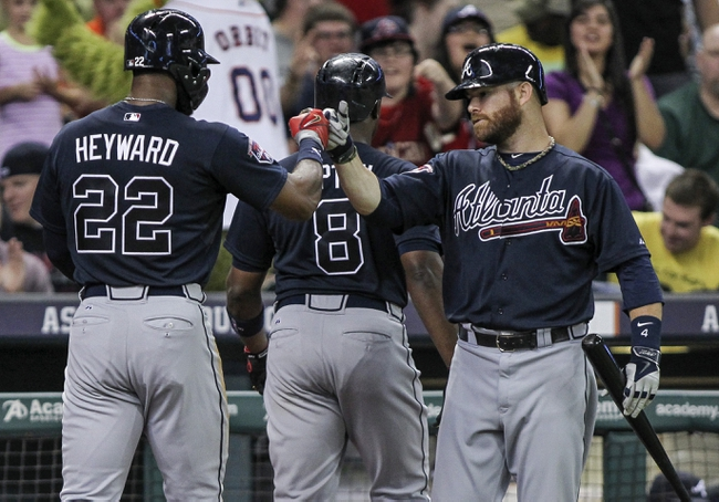Jun 25, 2014; Houston, TX, USA; Atlanta Braves right fielder Jason Heyward (22) is congratulated by designated hitter Ryan Doumit (4) after scoring a run during the seventh inning against the Houston Astros at Minute Maid Park. Mandatory Credit: Troy Taormina-USA TODAY Sports
