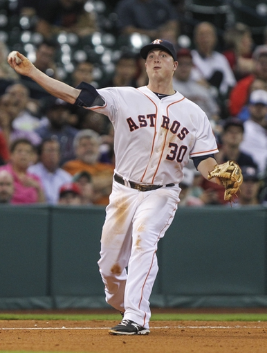 Jun 25, 2014; Houston, TX, USA; Houston Astros third baseman Matt Dominguez (30) throws to first base during the seventh inning against the Atlanta Braves at Minute Maid Park. Mandatory Credit: Troy Taormina-USA TODAY Sports
