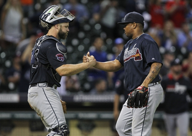 Jun 25, 2014; Houston, TX, USA; Atlanta Braves catcher Evan Gattis (24) and relief pitcher Juan Jaime (58) celebrate after defeating the Houston Astros 4-0 at Minute Maid Park. Mandatory Credit: Troy Taormina-USA TODAY Sports