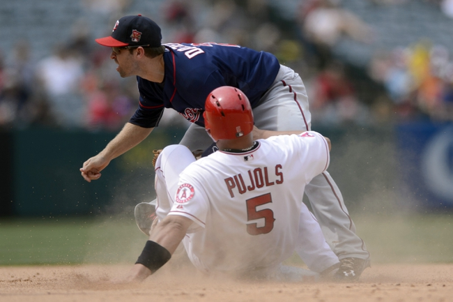 Jun 26, 2014; Anaheim, CA, USA; Los Angeles Angels designated hitter Albert Pujols (5) is forced out at second by Minnesota Twins second baseman Brian Dozier (2) as he attempts to steal second during the seventh inning at Angel Stadium of Anaheim. Mandatory Credit: Kelvin Kuo-USA TODAY Sports