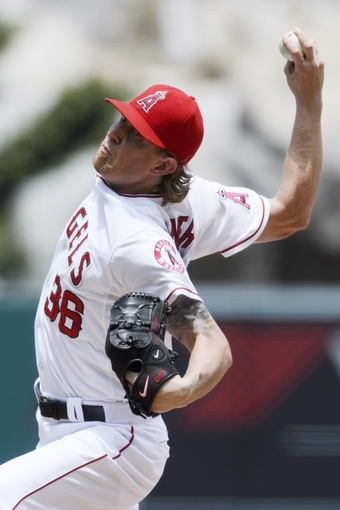 Jun 26, 2014; Anaheim, CA, USA; Los Angeles Angels starting pitcher Jered Weaver (36) pitches during the fourth inning against the Minnesota Twins at Angel Stadium of Anaheim. Mandatory Credit: Kelvin Kuo-USA TODAY Sports