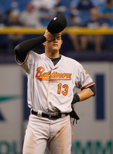 Jun 18, 2014; St. Petersburg, FL, USA; Baltimore Orioles third baseman Manny Machado (13) reacts against the Tampa Bay Rays at Tropicana Field. Baltimore Orioles defeated the Tampa Bay Rays 2-0. Mandatory Credit: Kim Klement-USA TODAY Sports