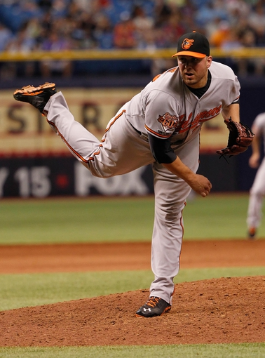 Jun 18, 2014; St. Petersburg, FL, USA; Baltimore Orioles relief pitcher Tommy Hunter (29) throws a pitch during the eighth inning against the Tampa Bay Rays at Tropicana Field. Baltimore Orioles defeated the Tampa Bay Rays 2-0. Mandatory Credit: Kim Klement-USA TODAY Sports