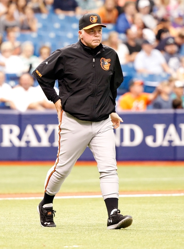 Jun 18, 2014; St. Petersburg, FL, USA; Baltimore Orioles manager Buck Showalter (26) against the Tampa Bay Rays at Tropicana Field. Mandatory Credit: Kim Klement-USA TODAY Sports