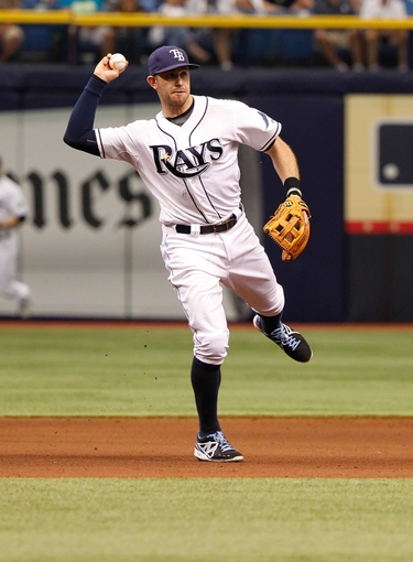 Jun 18, 2014; St. Petersburg, FL, USA; Tampa Bay Rays third baseman Evan Longoria (3) throws the ball to first for an out against the Baltimore Orioles at Tropicana Field. Mandatory Credit: Kim Klement-USA TODAY Sports