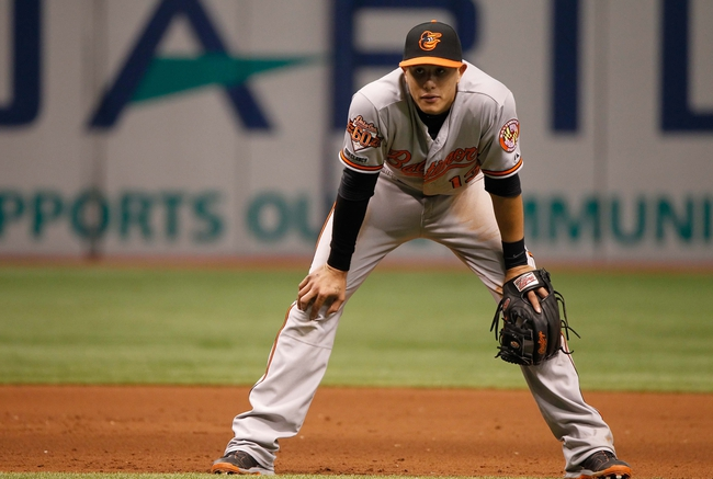 Jun 18, 2014; St. Petersburg, FL, USA; Baltimore Orioles third baseman Manny Machado (13) against the Tampa Bay Rays at Tropicana Field. Baltimore Orioles defeated the Tampa Bay Rays 2-0. Mandatory Credit: Kim Klement-USA TODAY Sports