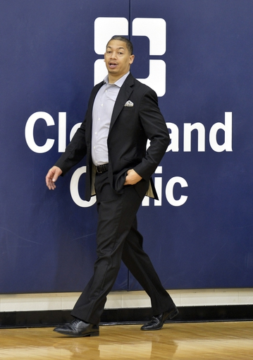 Jun 27, 2014; Independence, OH, USA; Cleveland Cavaliers associate head coach Tyronn Lue walks on the practice court at Cleveland Clinic Courts. Mandatory Credit: David Richard-USA TODAY Sports