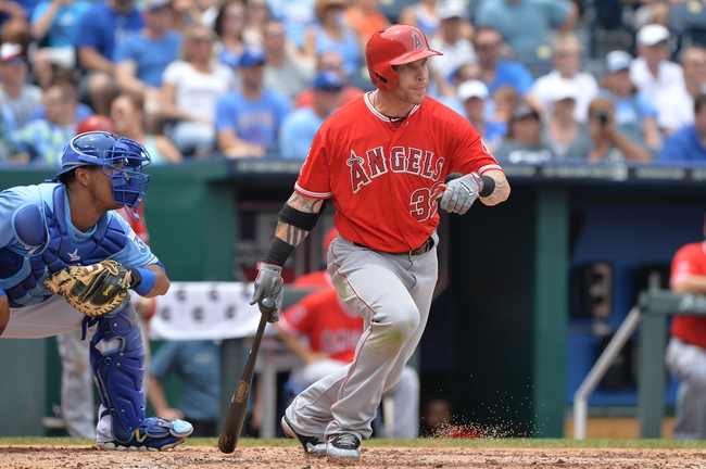Jun 29, 2014; Kansas City, MO, USA; Los Angeles Angels left fielder JOsh Hamilton (32) hits a RBI double against the Kansas City Royals during the third inning at Kauffman Stadium. Mandatory Credit: Peter G. Aiken-USA TODAY Sports