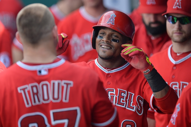 Jun 29, 2014; Kansas City, MO, USA; Los Angeles Angels shortstop Erick Aybar (2) celebrates in the dugout after hitting a solo home run against the Kansas City Royals during the sixth inning at Kauffman Stadium. Mandatory Credit: Peter G. Aiken-USA TODAY Sports