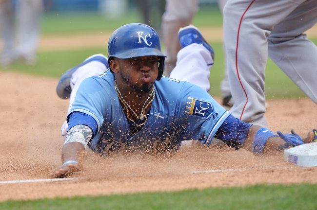 Jun 29, 2014; Kansas City, MO, USA; Kansas City Royals base runner Alcides Escobar (2) attempts to dive into third after getting tagged out in a rundown against Los Angeles Angels during the fifth inning at Kauffman Stadium. Mandatory Credit: Peter G. Aiken-USA TODAY Sports