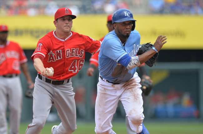 Jun 29, 2014; Kansas City, MO, USA; Kansas City Royals base runner Alcides Escobar (2) is caught in a rundown with Los Angeles Angels pitcher Cory Rasmus (46) during the fifth inning at Kauffman Stadium. Mandatory Credit: Peter G. Aiken-USA TODAY Sports