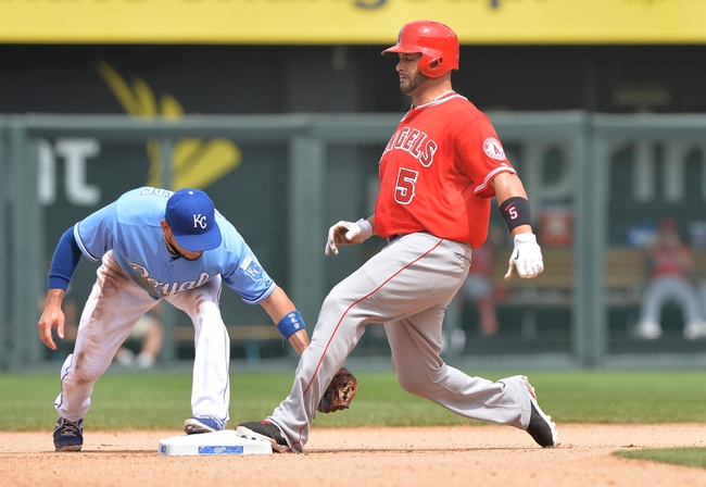 Jun 29, 2014; Kansas City, MO, USA; Los Angeles Angels base runner Albert Pujols (5) is tagged out at second by Kansas City Royals second basemen Omar Infante (14) trying to stretch a single into a double during the sixth inning at Kauffman Stadium. Mandatory Credit: Peter G. Aiken-USA TODAY Sports