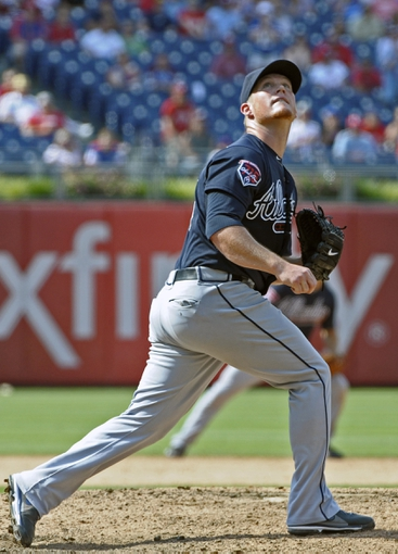 Jun 29, 2014; Philadelphia, PA, USA; Atlanta Braves relief pitcher Craig Kimbrel (46) watches pop up for final out against the Philadelphia Phillies at Citizens Bank Park. The Braves won 3-2. Mandatory Credit: Eric Hartline-USA TODAY Sports